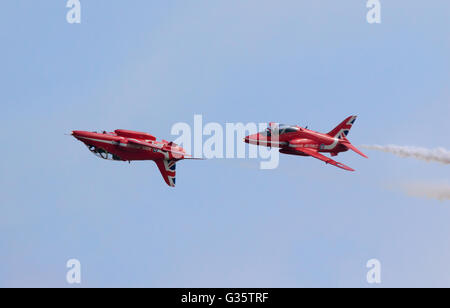 Two members of the Red Arrows RAF aerobatic team, one upside down, flying at the American Airshow, Duxford UK - Stock Photo