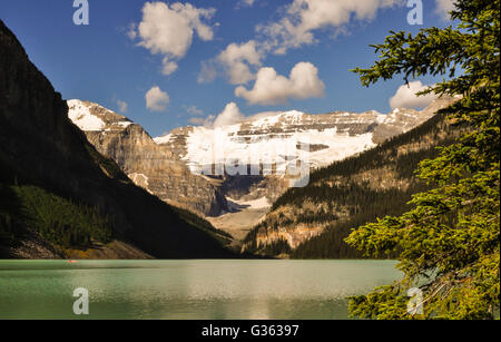 Still waters of Lake Louise on the Icefields Parkway in the Canadian Rockies. - Stock Photo
