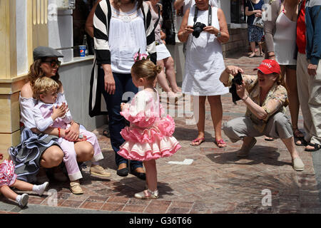 Attractive woman and child dressed in traditional costume at San Isidro festival fiesta in Nerja Andalucia Spain - Stock Photo