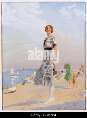 The Kodak Girl - a reminder to everyone to take  their Kodak camera with them to the seaside      Date: 1913 - Stock Photo
