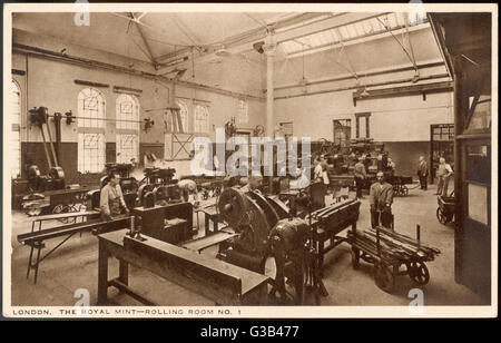 Rolling room no.1 at  the Royal Mint, where gold or  silver bars are rolled down  into strips of coin thickness - Stock Photo