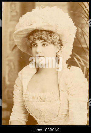 A young Victorian woman in matching hat and dress.        Date: circa 1890 - Stock Photo