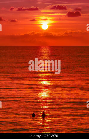 Sunset, ocean, Jamaica, Negril, White sands, beach, beautiful, colourful, romantic, blue water, swimming at night, - Stock Photo