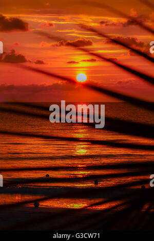 Sunset, ocean, Jamaica, Negril, White sands, beach, beautiful, colourful, romantic, blue water, romance - Stock Photo