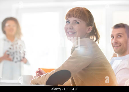 Smiling businesswoman in meeting - Stock Photo