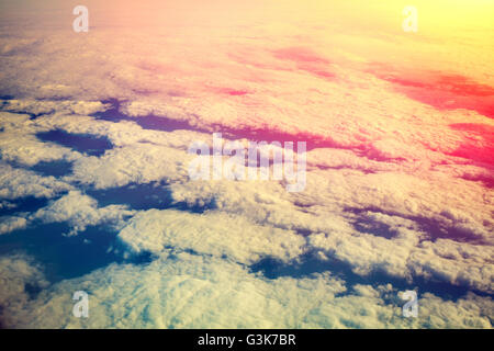Cloudy sky at sunrise. View from airplane window - Stock Photo
