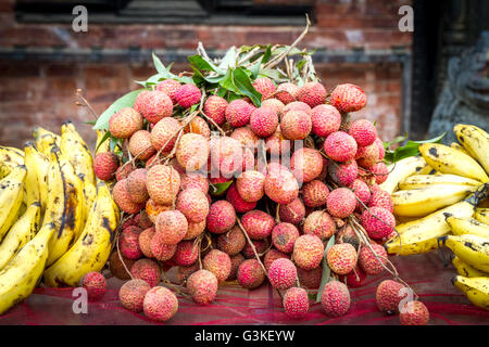 Organic fruits Litchi and Banana on sale in the street of Kathmandu,Nepal. - Stock Photo