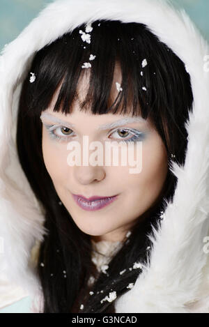 portrait woman with snow in hair - Stock Photo