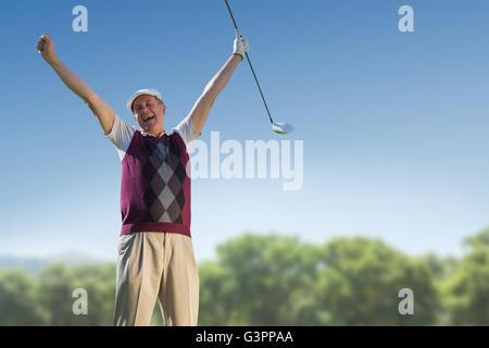 Golf player raising arms - Stock Photo