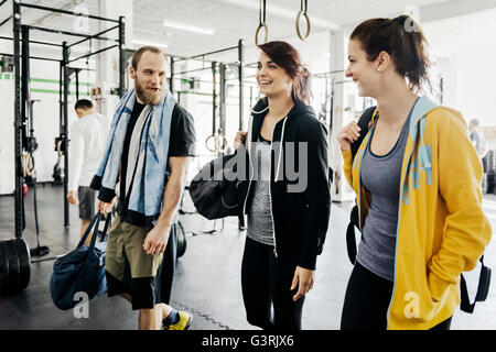Germany, Young women and man in gym - Stock Photo
