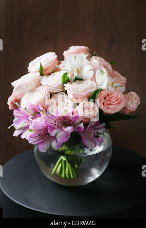 still life. a wooden antique table, glass vase with Mixed bouquet. beautiful flowers - Stockfoto