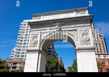 The Washington Square Arch at the bottom of Fifth Avenue in Greenwich Village in New York City, with the Empire - Stock Photo