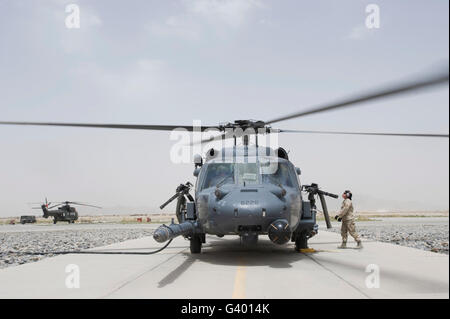 An HH-60 Pave Hawk lands after a flight to test mission readiness at Kandahar Air Field, Afghanistan. - Stock Photo