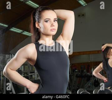 female body builder posing in studio Stock Photo, Royalty