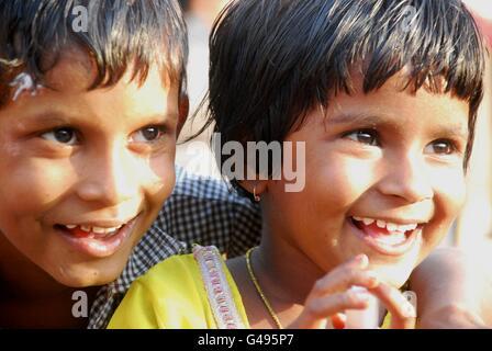 Portrait of boy and girl smiling, Jodphur, Rajasthan, India - Stock Photo