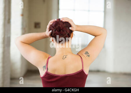 Distressed woman head in hands - Stock Photo
