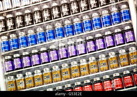 A shelf of nutritional supplements for muscle growth, bodybuilding, FIBO Power 2012 fitness fair, Essen, North Rhine - Stock Photo