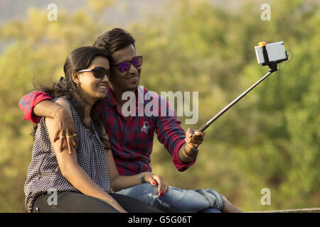 Young couple taking a selfie, Lavasa city, Pune, Maharashtra, India - Stock Photo