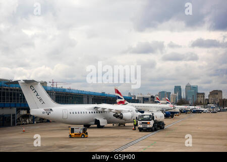 Horizontal view of aircraft waiting at the departure gates at London City Airport. - Stock Photo