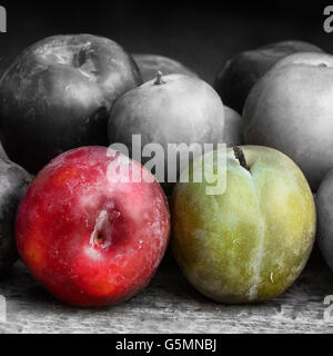 Sweet plums on a wooden background - Stock Photo