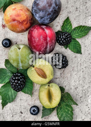 Sweet plums on wooden background - Stock Photo