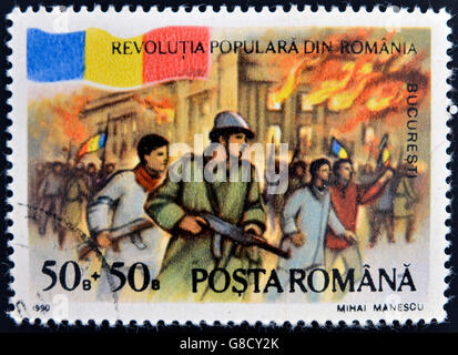 ROMANIA - CIRCA 1990: stamp printed in Romania dedicated to popular revolution shows Palace on fire, Bucharest, - Stockfoto