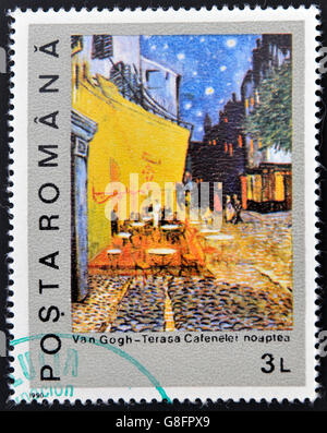 ROMANIA - CIRCA 1990: A stamp printed in Romania shows Night on the Coffee Terrace by Vincent Van Gogh, circa 1990 - Stockfoto
