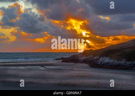 A panorama image of the sunset on Crantock Beach, near Newquay in Cornwall, UK. - Stock Photo