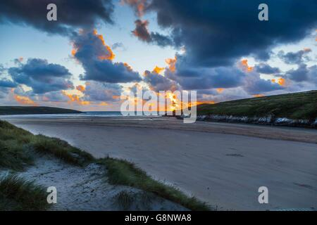 A sunset on Crantock Beach, near Newquay in Cornwall, UK. - Stock Photo