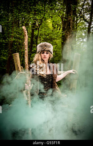 A young woman modeling for a Fantasy makeover 'game of thrones' style outdoors photography : Goddess / Priestess - Stockfoto