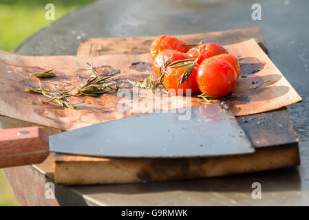 the tomatoes on the grill pan on the table - Stock Photo