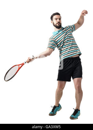 Action shot of tennis player hit ball in forehand pose. Full body length portrait isolated over white studio background. - Stock Photo