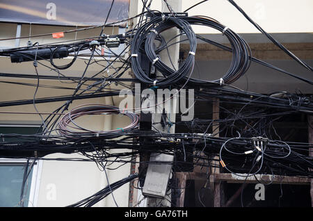 Messy Wires   Messy Wires On An Electric Pillar In Roatan Honduras Stock Photo