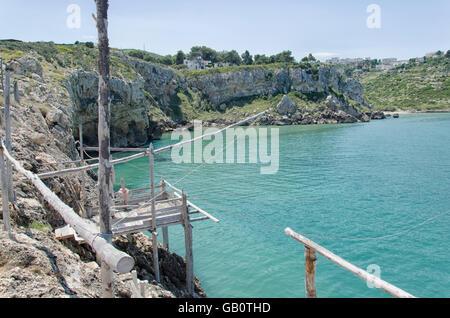 View of small trebuchet in the Gargano coast - Stock Photo