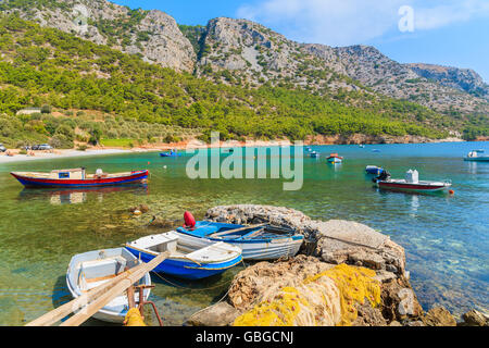 Traditional fishing boats in sea bay on secluded beach, Samos island, Greece - Stock Photo