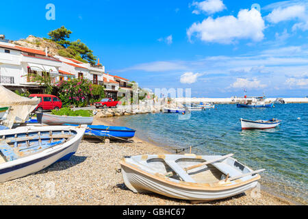 Fishing boats on beach in Kokkari village, Samos island, Greece - Stock Photo