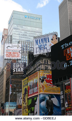 Barclay's Investment Bank Building (Barclays Capital) and bright theatrical musicals billboards near the Two Times - Stock Photo