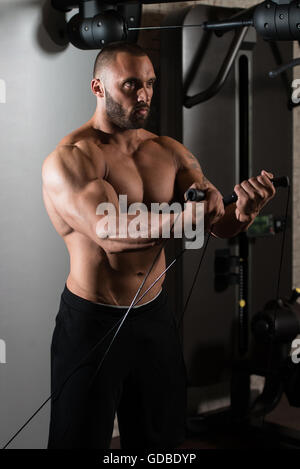 Big Man Is Working On His Chest With Cable Crossover In A Modern Gym - Stock Photo