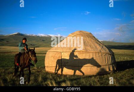Rider in front of a typical yurt, Moldo Too Range, Lake Song-Kul, Kirgizia - Stock Photo