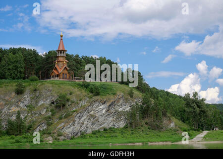 Beautifull wooden christian orthodox church on the bank of the river. Sts Kirill and Methodius chapel at Tomskaya - Stock Photo