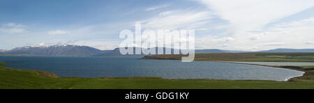 Iceland, Europe: view of the Icelandic landscape with lake, mountains and clouds near the long fjord of Akureyri, - Stock Photo