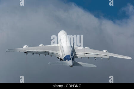 Airbus A380 airplane takes off into the sky - Stock Photo