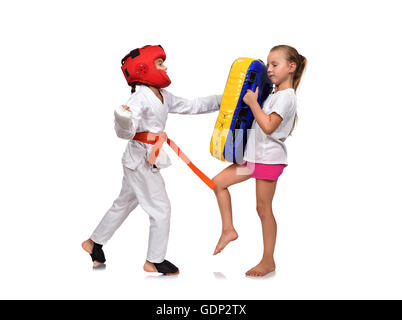 karate girl  It fulfills blows hand on a white background - Stock Photo