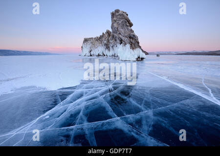 Ice and Ogoy Island, Baikal Lake, Olkhon Island, Siberia, Russia - Stock Photo