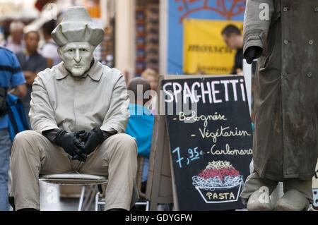 Advertising man of spaghetti pasta at Rue du Marche aux Fromages, Brussels, Belgium. Several restaurants at Rue - Stock Photo