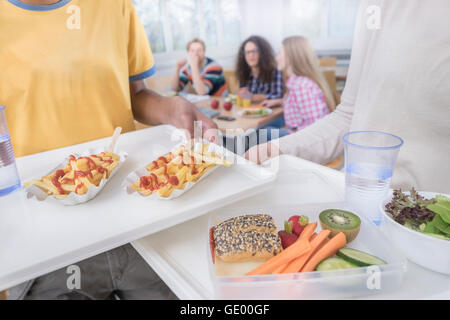 University students having lunch in canteen, Bavaria, Germany - Stock Photo