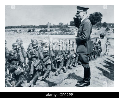 GERMAN INVASION POLAND Adolf Hitler saluting marching Wermacht troops during occupation of Poland WW2 - Stock Photo