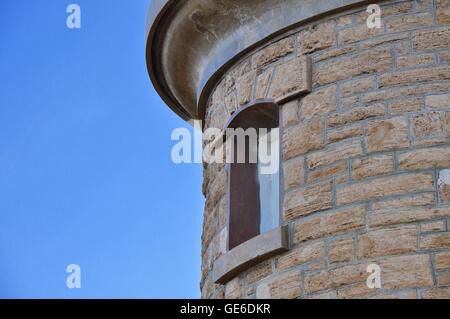 Abstract of the brown limestone brick of the Woodman Point Lighthouse with a bright blue sky in Coogee, Western - Stock Photo