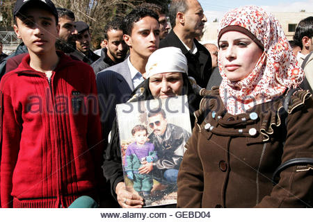 Relatives of Ahmed Daqamseh, a Jordanian soldier who was sentenced to life imprisonment for shooting dead seven - Stock Photo