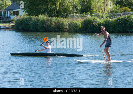 Men on Stand up paddle board and kayak on River Thames, Shepperton, Surrey, England, United Kingdom - Stock Photo